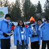 YES students, Hamzah, Aqsa, Mboyi, and Mahmoud are prepared to greet arrivals to the 2009 World Games.