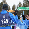 Aqsa is congratulating a Special Olympic athlete for completing a snowshoeing race.