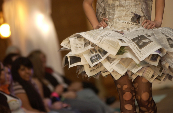 Record-Eagle/Garret Leiva<br /> Old newspapers were given new life at the Trashion fashion show.