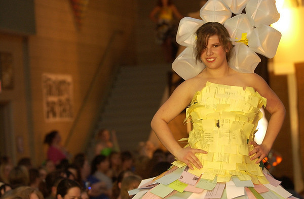 Record-Eagle/Garret Leiva<br /> West student Maria Leggett models her outfit created from hundreds of colored worksheets and a milk jug headdress.