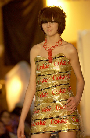 Record-Eagle/Garret Leiva<br /> Elk Rapids student Mimi Nichol models a dress made entirely of Diet Coke 2-liter labels, along with a Coke bottle cap necklace. The dress, created by West student Kristi Weighman, won third place at the Trashion fashion show.