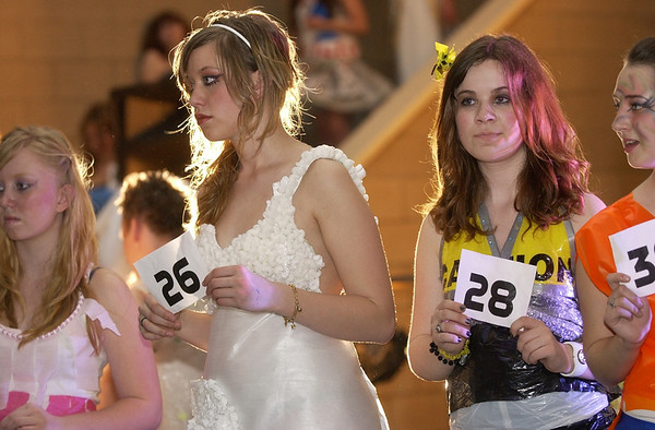 Record-Eagle/Garret Leiva<br /> Trashion show models line up on the runway as audience members write down numbers to cast a vote for the Viewer's Choice award.