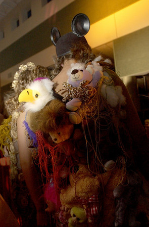 """Record-Eagle/Garret Leiva<br /> West student Katie Wright models her creation """"Hugs from a 1,000 Friends"""" that utilizes nearly 50 stuffed animals. The dress won the Creative Creature award."""