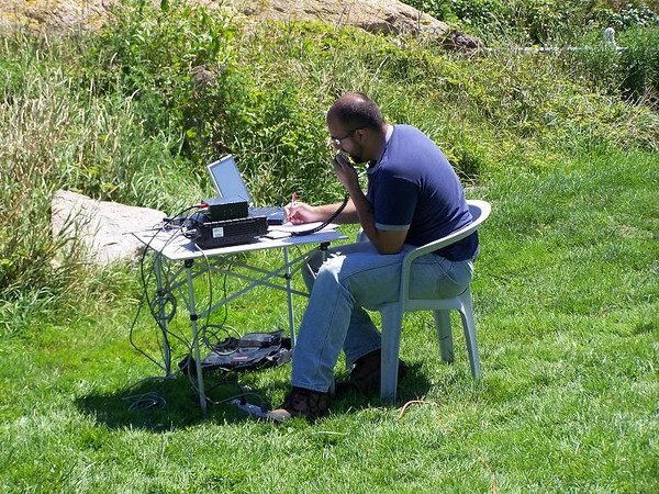 Ham radio operator contacting someone on another continent.