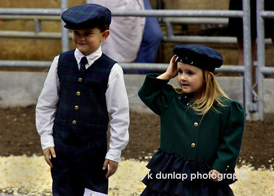 Brother and sister showing off their wool outfits at the sheep lead.  What little cuties.