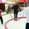 "Record-Eagle/Douglas Tesner<br /> Lynn Peterson, left,  and her daughter Amy Peterson receive instructions on ""Hoopini"" from Karen Bell, center, the owner of Hoopin' For The Health 0f It, during the 11th Annual Women's Winter Tour at Crystal Mountain."