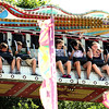 Record-Eagle/Keith King<br /> Riders quickly descend while sitting on the 1,001 Nights ride at the Arnold Amusements Midway Saturday, July 3, 2010 during the National Cherry Festival.