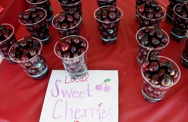 Record-Eagle/Keith King<br /> Sweet cherries are displayed from Gallagher's Farm Market near the Open Space Saturday, July 3, 2010 during the National Cherry Festival.
