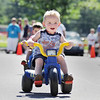 Record-Eagle/Keith King<br /> Ryan Wiggins, 3, of Traverse City, pedals quickly Saturday, July 3, 2010 during the Kids' Big Wheel Race at the Traverse City Civic Center parking lot.