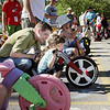 Record-Eagle/Keith King<br /> Doug Covert, of Traverse City, gives some last-minute pointers to his daughter, Isabella Covert, 4, Saturday, July 3, 2010 during the Kids' Big Wheel Race at the Traverse City Civic Center parking lot.