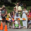 Record-Eagle/Keith King<br /> Amy Denton, middle, cheers for her daughter, Claire Denton, 4, Saturday, July 3, 2010 during the Kids' Big Wheel Race at the Traverse City Civic Center parking lot.