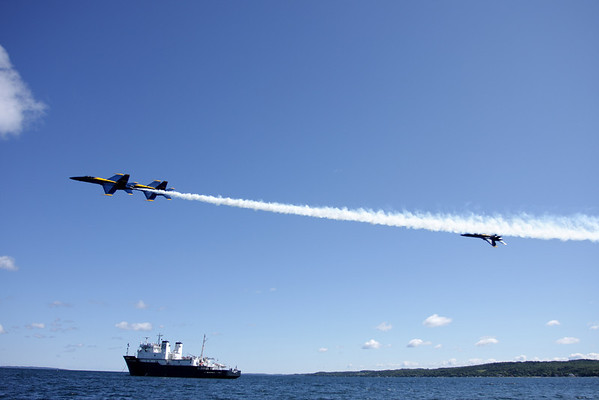 Record-Eagle/ Keith King<br /> U.S. Navy Blue Angels Boeing F/A-18 Hornet aircraft fly over West Grand Traverse Bay and the Great Lakes Maritime Academy's T/S State of Michigan training vessel Wednesday, June 30, 2010 during a Blue Angels' practice session.