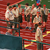Boy scout troop 140 gathers by the field in preparation to present the colors.