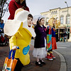 Record-Eagle/Keith King<br /> Ethan Rademacher, from left, 3, dressed as a banana, his sister, Sydney Rademacher, 5, dressed as a bride and their cousin, Avery Bills, 5, dressed as Supergirl, wait for the light to change at the intersection of Cass Street and Front Street Friday, October 29, 2010 as they go trick-or-treating during the Downtown Halloween Walk.