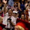 """David Fellows, left, Jim Fellows and Jani Fellows, wave to their graduate as the  Fairview seniors enter the Coors Events Center on Sunday.<br /> For more photos and a video, go to  <a href=""""http://www.dailycamera.com"""">http://www.dailycamera.com</a>.<br /> Cliff Grassmick / May 23, 2010"""