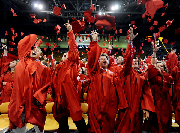 """Fairview graduates Max Schein, left, Nick Morell, Chris Williams,  William Wilsted, and Katelyn Wojciechowski, join classmates in throwing their caps in the air. It was Fairview's 50th graduation.<br /> For more photos and a video, go to  <a href=""""http://www.dailycamera.com"""">http://www.dailycamera.com</a>.<br /> Cliff Grassmick / May 23, 2010"""