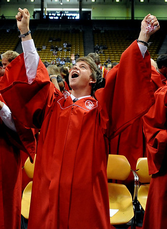 "Chris Williams raises his arms in celebration as he graduates with fellow Fairview seniors on Sunday at the Coors Events Center.<br /> For more photos and a video, go to  <a href=""http://www.dailycamera.com"">http://www.dailycamera.com</a>.<br /> Cliff Grassmick / May 23, 2010"