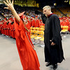 "Fairview graduate Anna Burger, left, does the secret student council handshake with principal Don Stensrud after she gets her diploma on Sunday.<br /> For more photos and a video, go to  <a href=""http://www.dailycamera.com"">http://www.dailycamera.com</a>.<br /> Cliff Grassmick / May 23, 2010"