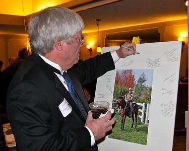 Dan signing Larry's portrait