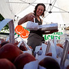 "Darcey Lopez,  of Red Fox Run Ochards, puts out more bags of peaches.<br /> The 2010 Lafayette Peach Festival was held in downtown Lafayette on Saturday.<br /> For more photos and a video of the festival, go to  <a href=""http://www.dailycamera.com"">http://www.dailycamera.com</a>.<br /> Cliff Grassmick / August 21, 2010"