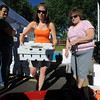 "Sandra Pike of Tate Orchard of Palisade, CO., loads up a box of peaches for Susie Callihan, right, of Broomfield.<br /> The 2010 Lafayette Peach Festival was held in downtown Lafayette on Saturday.<br /> For more photos and a video of the festival, go to  <a href=""http://www.dailycamera.com"">http://www.dailycamera.com</a>.<br /> Cliff Grassmick / August 21, 2010"