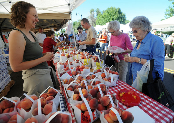 "Darcey Lopez, left,  of Red Fox Run Ochards, helps Ginnie Ward, left, and Dorothy Kinnie with peach selection.<br /> The 2010 Lafayette Peach Festival was held in downtown Lafayette on Saturday.<br /> For more photos and a video of the festival, go to  <a href=""http://www.dailycamera.com"">http://www.dailycamera.com</a>.<br /> Cliff Grassmick / August 21, 2010"