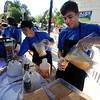 "Ryan Ebersole, right, and other members of the Centaurus High School soccer team, make peach smoothies and serve up other peach treats during the festival.<br /> The 2010 Lafayette Peach Festival was held in downtown Lafayette on Saturday.<br /> For more photos and a video of the festival, go to  <a href=""http://www.dailycamera.com"">http://www.dailycamera.com</a>.<br /> Cliff Grassmick / August 21, 2010"
