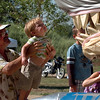 "Carl York of Boulder, holds up his grandson, Grayson, 2,  to get a better look at the shark vehicle, as sister Lannie, 4, checks underneath.<br /> The 2010 Longmont Kinetic Sculpture Race was held at Union Reservoir on Saturday. For more photos and a video of Kinetics, go to  <a href=""http://www.dailycamera.com"">http://www.dailycamera.com</a>.<br /> Cliff Grassmick / August 28, 2010"