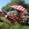 """The """"Who are these Clowns?"""" team, has a little trouble with the rough terrain, but makes it through.<br /> The 2010 Longmont Kinetic Sculpture Race was held at Union Reservoir on Saturday. For more photos and a video of Kinetics, go to  <a href=""""http://www.dailycamera.com"""">http://www.dailycamera.com</a>.<br /> Cliff Grassmick / August 28, 2010"""