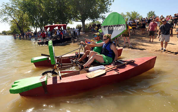 """The Longmonsters team heads out into the reservoir.<br /> The 2010 Longmont Kinetic Sculpture Race was held at Union Reservoir on Saturday. For more photos and a video of Kinetics, go to  <a href=""""http://www.dailycamera.com"""">http://www.dailycamera.com</a>.<br /> Cliff Grassmick / August 28, 2010"""