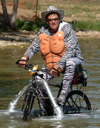 "Darren Droge, who makes up the ""Zebra Muscles are spreading the love, warms up in the water.<br /> The 2010 Longmont Kinetic Sculpture Race was held at Union Reservoir on Saturday. For more photos and a video of Kinetics, go to  <a href=""http://www.dailycamera.com"">http://www.dailycamera.com</a>.<br /> Cliff Grassmick / August 28, 2010"