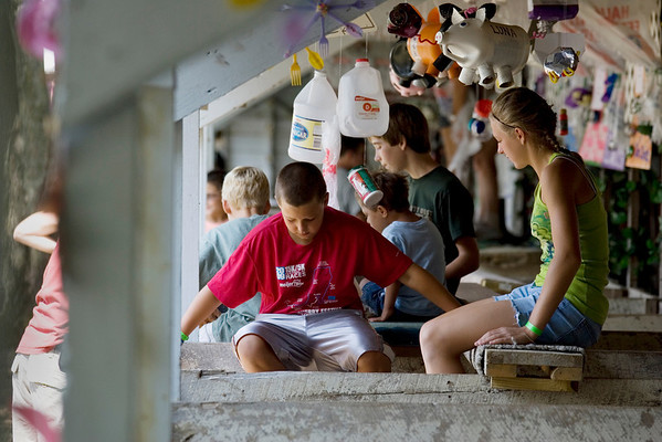 Record-Eagle/Keith King<br /> Carley Drzewiecki, 13, and her brother, Cameron Drzewiecki, 10, of Traverse City, sit in the pig barn with their pigs Saturday, August 7, 2010 during the Northwestern Michigan Fair.