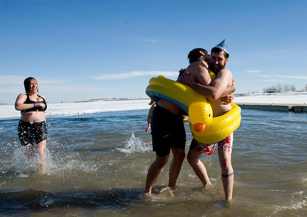 Adam Svigel (right) of Englewood, and Jesse Gettert, of Denver, hug after running into the freezing water during the annual Polar Bear Plunge into the Boulder Reservoir New Year's Day, 2010. <br />  <br /> KASIA BROUSSALIAN