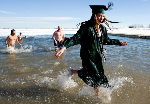 Niwot High School May 2009 graduate Mackenzie Haas runs out of the water during the annual Polar Bear Plunge into the Boulder Reservoir New Year's Day, 2010. <br />  <br /> KASIA BROUSSALIAN