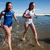 Two participants, both of Longmont, run out of the water during the annual Polar Bear Plunge into the Boulder Reservoir New Year's Day, 2010. The girls were writing an article for their school newspaper, documenting their plunge. <br />  <br /> KASIA BROUSSALIAN