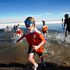 Caitlin Welch, 8, makes a dash for the hot tubs after running into freezing water during the annual Polar Bear Plunge into the Boulder Reservoir, New Year's Day, 2010. <br />  <br /> KASIA BROUSSALIAN