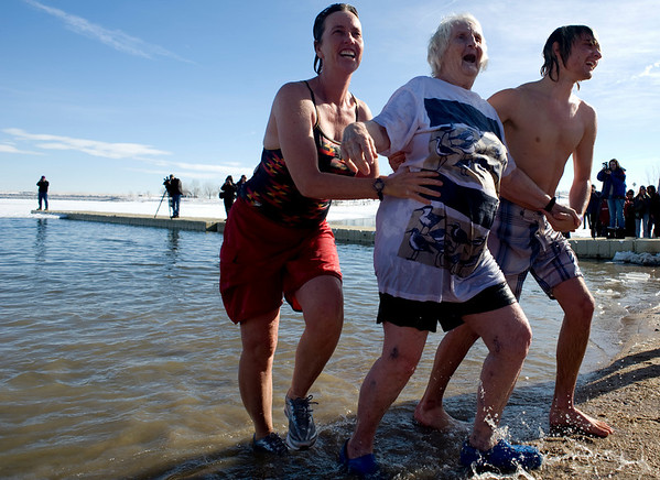 80-year-old Vera Mead walks out of the water, with the support of her grandson, Jasper Taylor, and daughter, Simone Mead, during the annual Polar Bear Plunge into the Boulder Reservoir New Year's Day, 2010. <br />  <br /> KASIA BROUSSALIAN