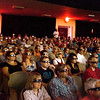 """Record-Eagle/Keith King<br /> Movie goers watch the 3-D movie, """"Cane Toads: The Conquest,"""" Thursday, July 29, 2010 in Lars Hockstead Auditorium at Central Grade School during the Traverse City Film Festival."""