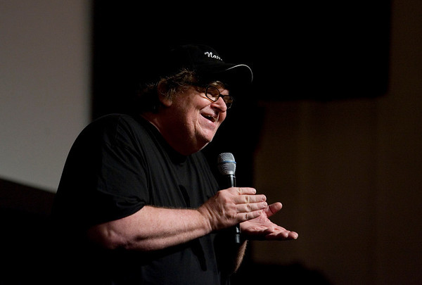 Record-Eagle/Keith King<br /> Michael Moore talks to the crowd in Lars Hockstead Auditorium prior to revealing the Mike's Surprise movie Sunday, August 1, 2010 at Central Grade School during the Traverse City Film Festival.