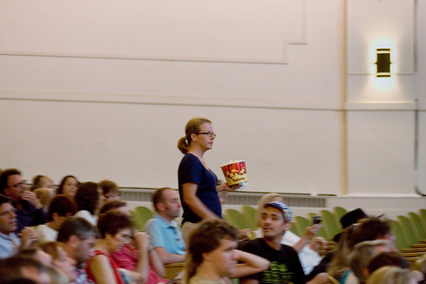 Record-Eagle/Keith King<br /> Tracy Jenkins, of Lake Ann, walks toward her seat with some popcorn to see the Mike's Surprise movie in Lars Hockstead Auditorium Sunday, August 1, 2010 at Central Grade School during the Traverse City Film Festival.