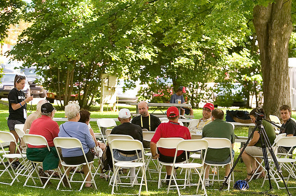 """Record-Eagle/Jan-Michael Stump<br /> People gather in Lay Park to discuss """"American Radical: The Trials of Norman Finkelstein,"""" with directors David Ridgen (cq) and Nicolas Rossier (cq) at a Traverse City Film Festival Film Forum on Friday afternoon."""