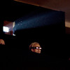 """Record-Eagle/Keith King<br /> Carl Bean-Larson, of Traverse City, tries on his 3-D glasses Thursday, July 29, 2010 prior to the showing of the movie, """"Cane Toads: The Conquest,"""" in Lars Hockstead Auditorium at Central Grade School during the Traverse City Film Festival."""