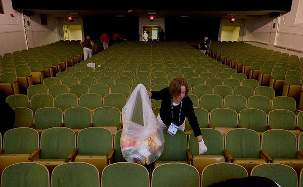 Record-Eagle/Keith King<br /> Volunteer Sandy Miller, of Traverse City, holds a trash bag as she and other volunteers clean Lars Hockstead Auditorium Sunday, August 1, 2010 prior to the next movie being shown there during the Traverse City Film Festival.