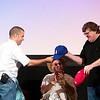 "Record-Eagle/Jan-Michael Stump<br /> Cuban director Ian Padron (cq) gives filmmaker Michael Moore a Cuban baseball hat as director Juan Carlos Cremata Malberti watches during Friday's ""We Live in Cuba and We Make Movies,"" panel at the City Opera House."