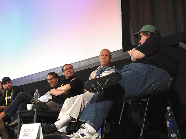 Record-Eagle/Sheri McWhirter<br /> <br /> Traverse City Film Festival founder Michael Moore leads the discussion and asks other filmmakers questions during a Saturday panel session about documentaries.