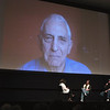 """Daniel Ellsberg speaks via Skype at Lars Hockstad Auditorium Saturday. """"The Most Dangerous Man in America"""" was screened with filmmakers Judith Ehrlich, left, and Rick Goldman, center. Festival founder Michael Moore, right, moderates the discussion."""