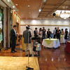 Toshinobu Toyama and Kei Nagai lead a bingo game at the L&C Tokyo alumni event.