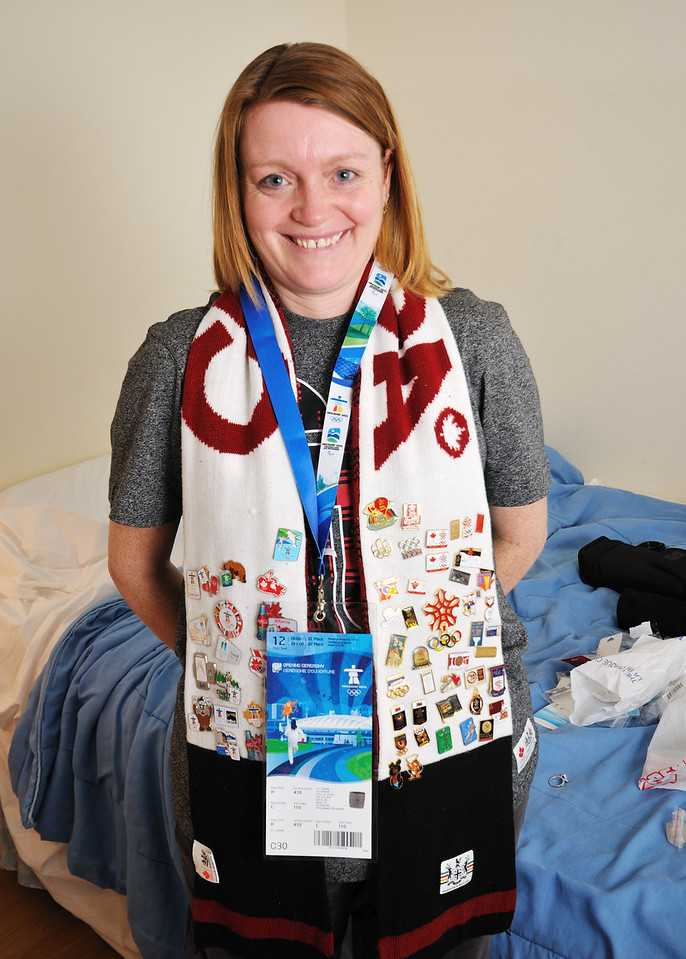 Jen showing off her pin collection, from both 1988 in Calgary and the Vancouver games.