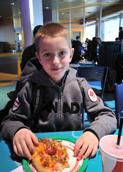 Conor having Pizza for lunch at the Calgary airport.
