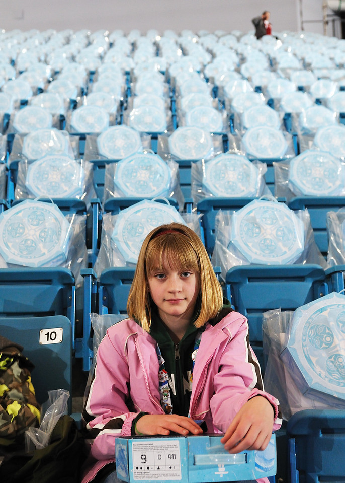 Clare with empty seats behind her.